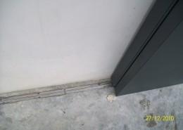 Particolare portone EBE65, binario di scorrimento a pavimento